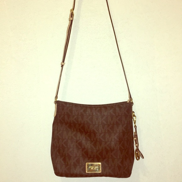 Michael Kors Handbags - Cross body never worn brown and cream